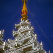 Golden spires of Buddhist stupas in temple — Stock Photo #13509159