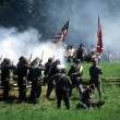 Confederates volley fire on advancing Union soldiers, - Stock Photo