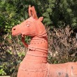 Stock Photo: Terrcotthorses in folk art garden