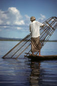 Leg rowing fisherman — Stock Photo