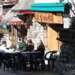 Stock Photo: Apres ski - skiers relax in outdoor tavern