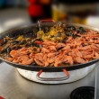 Shrimp, mussels and paella — Stock Photo #13510335