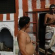Stock Photo: Brahmin priests of Shivprepare sacred fire for ceremonies