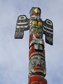 Totem pole topped by thunderbird, — Stock Photo