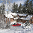 Stock Photo: Winter snow on large modern home