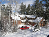 Winter snow on large modern home — Photo