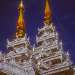 Golden spires of Buddhist stupas in temple — Stock Photo