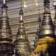 Stock Photo: Golden spires of Buddhist stupas in temple