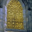 Stock Photo: Window with golden grill work, St. Vitus Cathedral