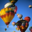 Stockfoto: Tourists ride hot air ballons