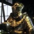 Tournment armor of late medieval knight with sword, — Stock Photo