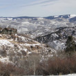Stock Photo: Large houses overlook snowy valley