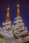 Golden spires of Buddhist stupas in temple — Stock Photo