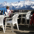 Skiers relax at a high mountain restaurant — Stock Photo