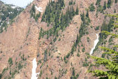 Exposed steep rocky face of Red Mountain, — Stock Photo