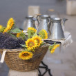 Sunflowers and pewter work for sale — Stock Photo