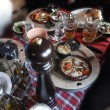 Stock Photo: Hearty skiers Savoyard lunch