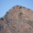 Exposed steep rocky face of Red Mountain — Stok fotoğraf