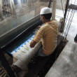 Young muslim mruns loom to weave silk brocade — Stock Photo #18345521