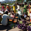 Tribal women sell vegetables  in weekly market - Stock Photo