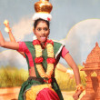 Indian dancer performs classical dance - Stock Photo