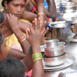 Tribal women sell home brewed liquor from large metal pots - Stock Photo