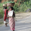 Women carry goods on their heads for  weekly market -  