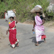 Women carry goods on their heads for  weekly market - Stock Photo