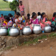 Tribal women sell home brewed liquor from large metal pots — Stock Photo