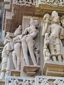 Apsara naked dancers in candid poses; sculpture — Stock Photo