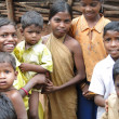 Stock Photo: Tribal children greet visitors