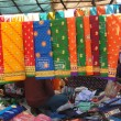 Colorful saris are on sale at the weekly market — Stock Photo