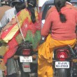 Women in sarees ride side saddle - Stock Photo