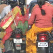 Stock Photo: Women in sarees ride side saddle