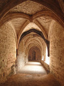 Medieval cloister with vaulted arches — Stock Photo