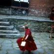 Buddhist monk practising dance — Stock Photo