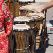 Постер, плакат: Drummers playing at a Saturday market