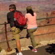 Tourists enjoy the view overlooking the South Rim — Stock Photo #36744797
