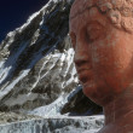 Head of Buddha, with Himalyan glaciated peak — Stock Photo
