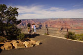 Tourists enjoy the view overlooking the South Rim — Stock Photo