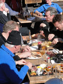 A group of skiers have a leisurely lunch outdoors — Stock Photo