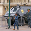 Stock Photo: Riot police stand ready near armored car