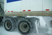 Truck tires spinning on highway during snowstorm — Stock Photo