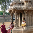 Foto de Stock  : Inditourists explore ancinet temples of Five Rathas