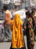 Hindu woman in bright orange scarf visits the Lad Bazaar — Stock Photo