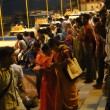 Photo: Peoeple gather on ghats in cool evening