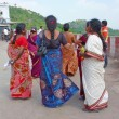 Stock Photo: Hindu women prepare to enter temple