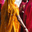Colorful Indiwomen form wedding procession — Stock Photo #38022805