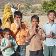 Stock Photo: Children greet visitors with traditional namaste