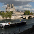 Tourist boat floats past the Louvre — Stock Photo #38169425